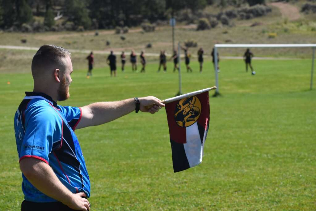 An official makes a signal during a rugby game at Colorado Mountain College, Spring Valley campus on Saturday.  Ray K. Erku / Post Independent