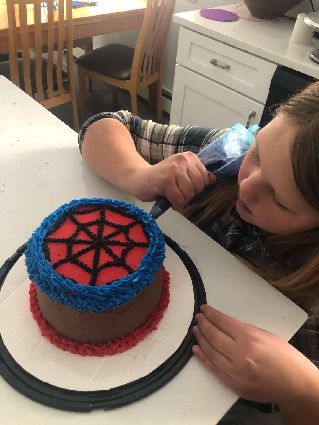 River Close works on a Spiderman-themed cake design. | Photo by Andrea Beacham