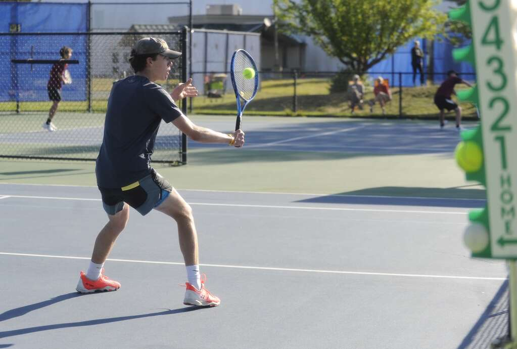 Liam Siefken, a freshman on the Steamboat Springs boys tennis team plays in the No. 1 doubles match during a home competition against Rocky Mountain High School on Saturday morning. | Shelby Reardon/Steamboat Pilot & Today
