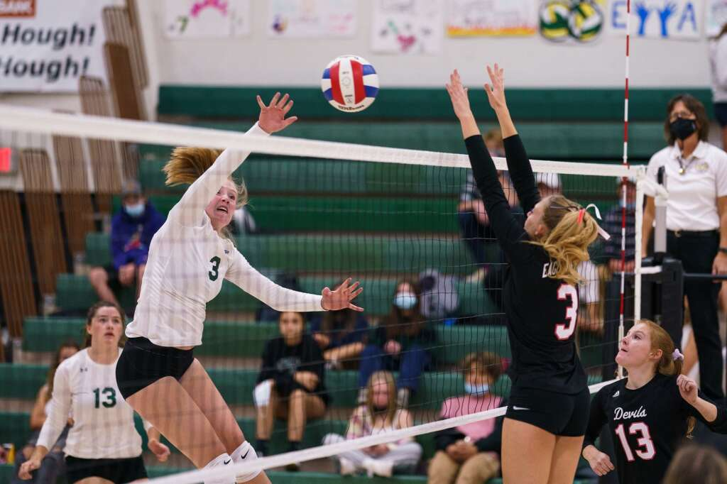 Summit High School sophomore Hannah Crowe spikes the ball during the first set in the homecoming match against the Eagle Valley Devils on Monday, Sept. 20, at Summit High School in Breckenridge. | John Hanson/For the Summit Daily News