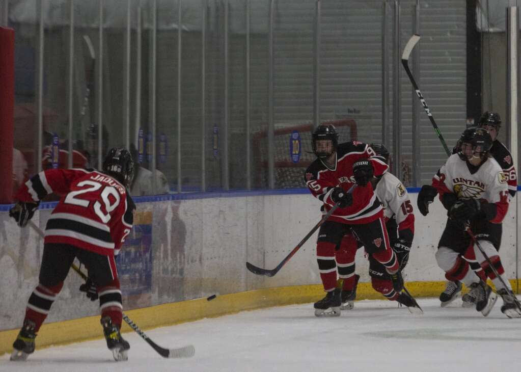 Park City High School's Shane Agee (95) passes the puck to teammate Erich Jaques (29) during the Miners' matchup against Uintah at the Park City Ice Arena Saturday evening, Sept. 25, 2021. The Miners defeated the Utes 6-0. (Tanzi Propst/Park Record)