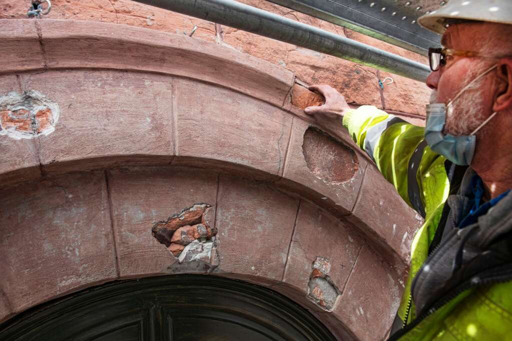 Mike Schultheis, general superintendent of Summit Sealants and Restoration, points out the areas replaced on the arches at the top of the Wheeler Opera House in Aspen on Wednesday, March 24, 2021. (Kelsey Brunner/The Aspen Times)