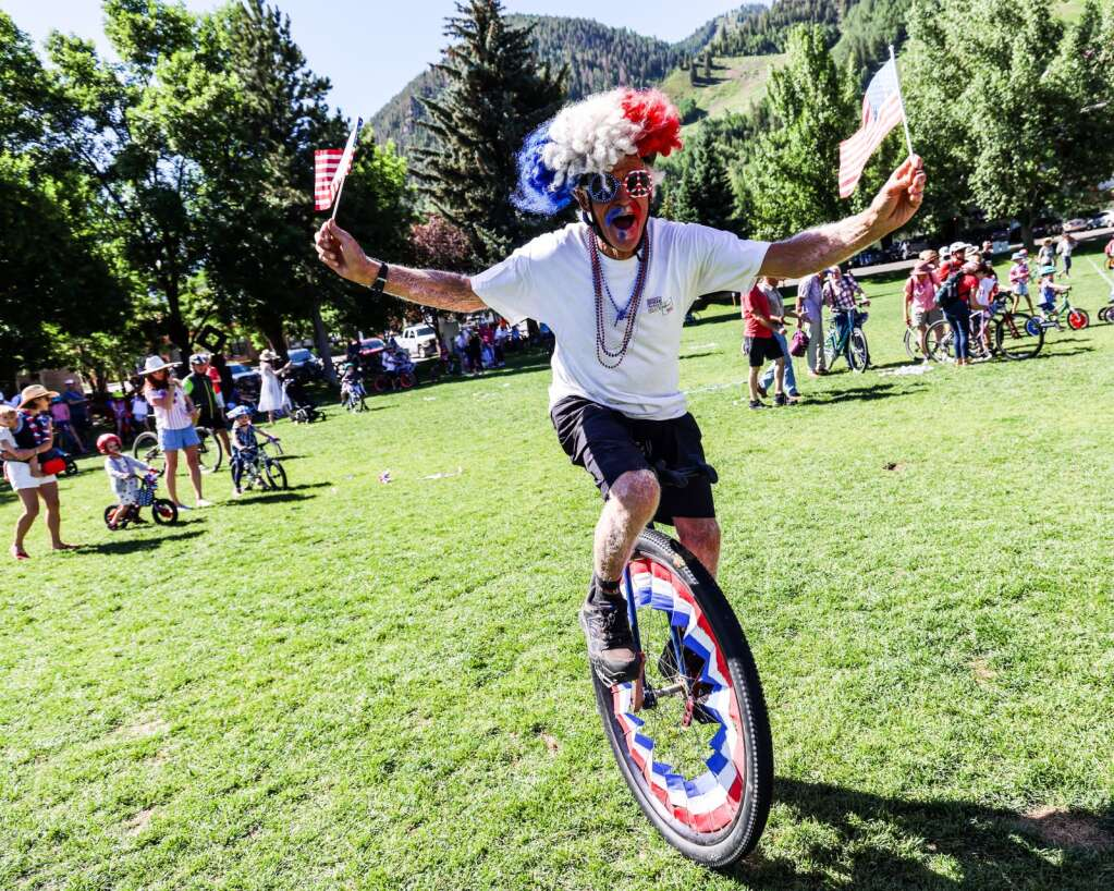Mike Tierney rides his unicycle during the Fourth of July celebration in Aspen on Sunday, July 4, 2021, in downtown Aspen. Photo by Austin Colbert/The Aspen Times.