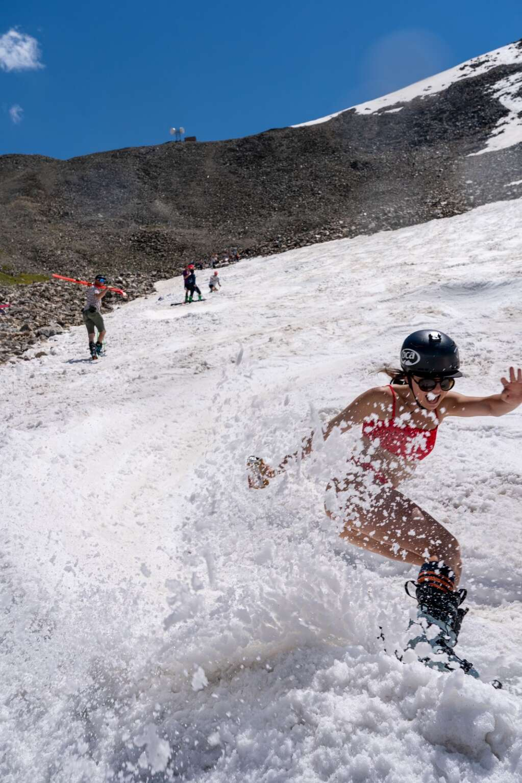 Skiers and riders celebrate Independence Day high up in the Tenmile Range ripping up summer slush at Fourth of July Bowl on Peak 10 at Sunday's fourth annual Peak 10 Classic. | Photo by Sage Vogt
