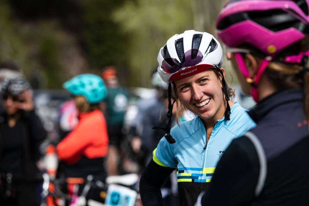 Rae Conlon talks with a friend before the 2021 annual Ride for the Pass event starting in Aspen on Saturday, May 22, 2021. This is Conlon's first year participating in the bike ride. (Kelsey Brunner/The Aspen Times)