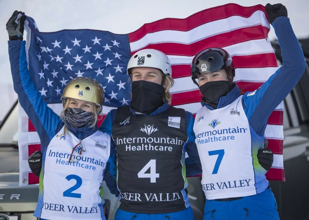 Team USA's Winter Vinecki, from left, Justin Schoenfeld and Kalia Kuhn celebrate a second, second and third place finish, respectively, among the aerialist athletes. (Tanzi Propst/Park Record)