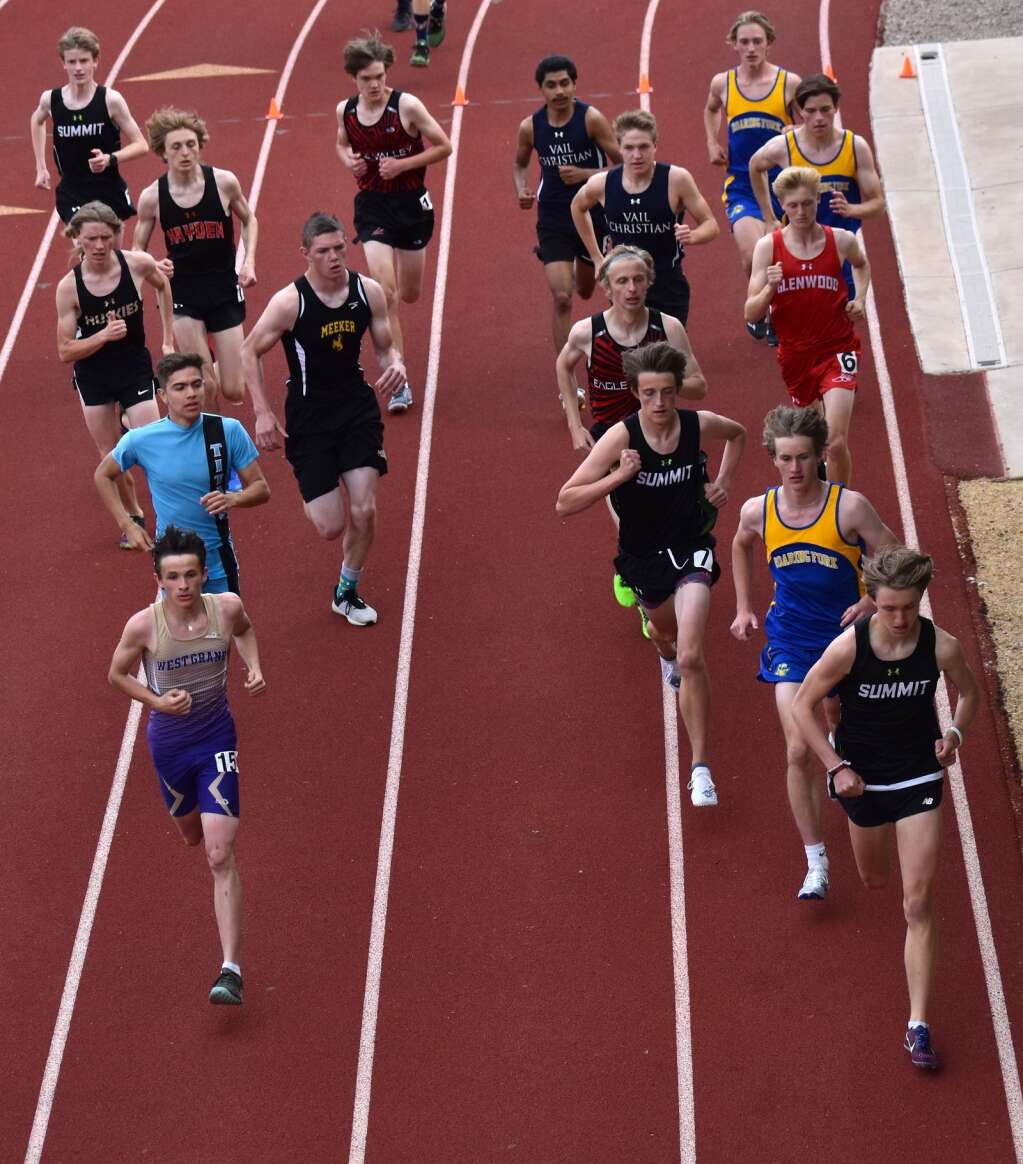 The boys 1600 meter field breaks to the pole on the first lap Saturday.| John Stroud/Post Independent