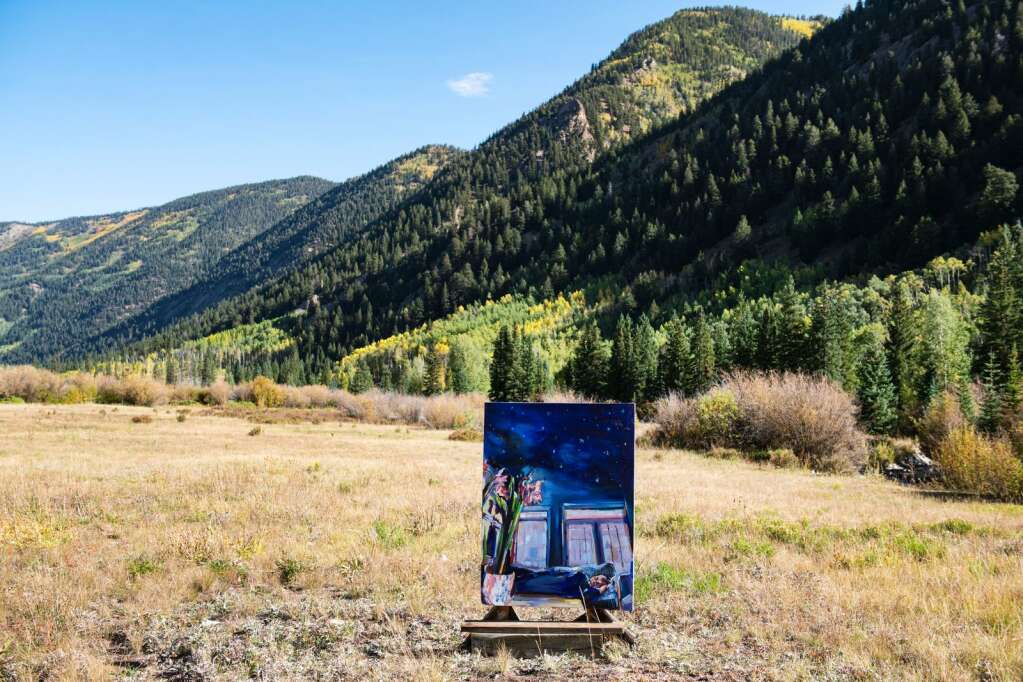 A painting by Denver-based artist Kaitlyn Tucek is displayed in a field leading into the Ashcroft Ghost Town as part of her temporary two-day exhibition 'The Lilac Hour' outside of Aspen on Friday, Sept. 17, 2021. (Kelsey Brunner/The Aspen Times)