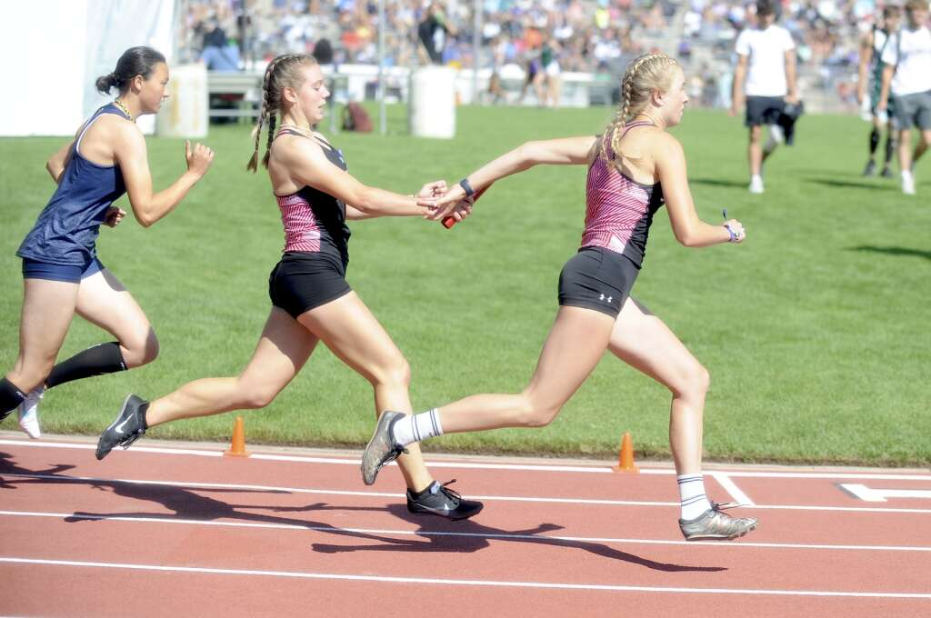 Steamboat Springs senior Elise Colby passes the baton to senior Marcada Baker during the 4x100 prelims at the CHSAA Track and Field State Championships at JeffCo Stadium on Friday. (Photo by Shelby Reardon)