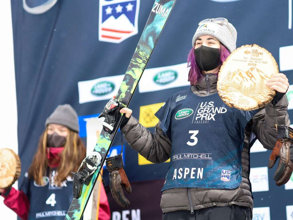 Canada's Rachael Karker, right, stands atop the podium with Great Britain's Zoe Atkin in the back after the women's freeski halfpipe final at the U.S. Grand Prix and World Cup on Sunday, March 21, 2021, at Buttermilk Ski Area in Aspen. Photo by Austin Colbert/The Aspen Times.