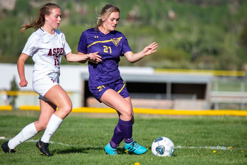 Aspen High School's Alexis Cordts-Pearce, left, and Basalt's Josie Day play during the varsity game at Basalt High School on Thursday, May 20, 2021. (Kelsey Brunner/The Aspen Times)