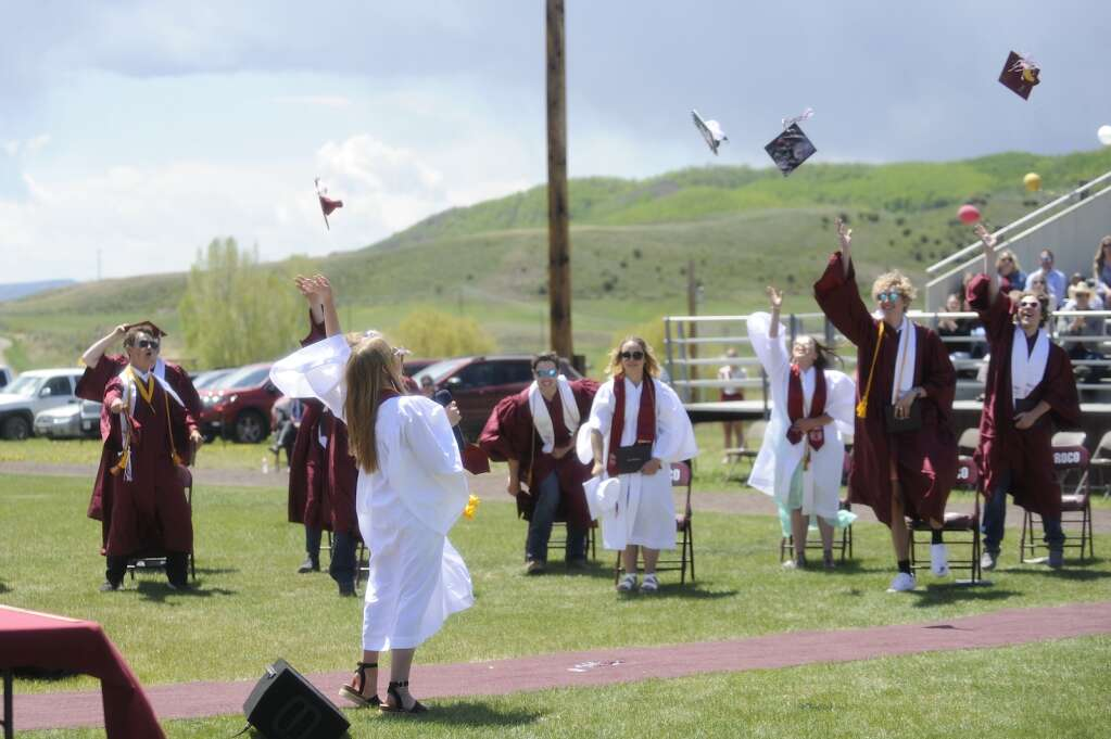 The class of 2021 throws grad caps during the Soroco High School graduation ceremony on Saturday morning.