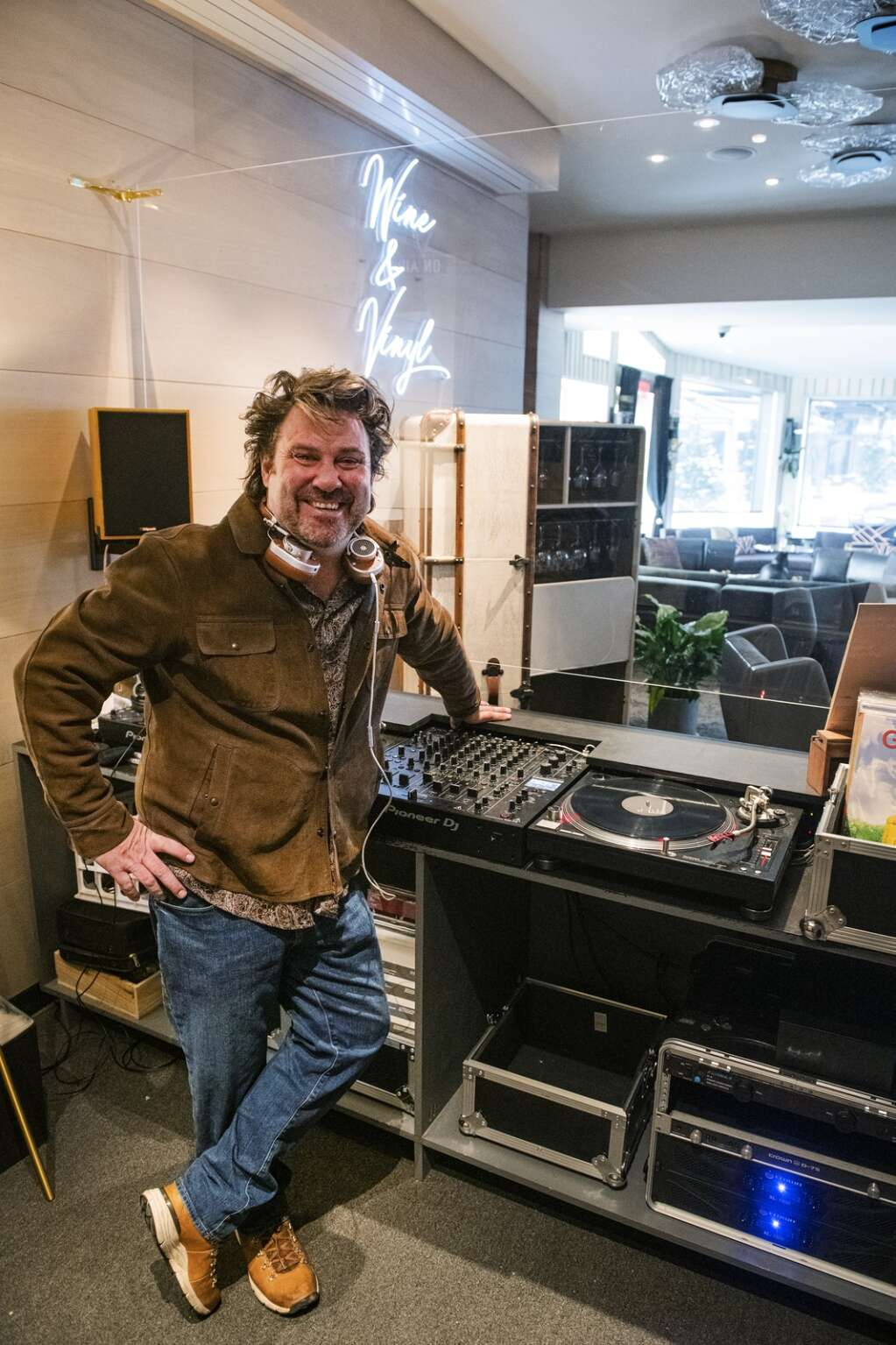 Local DJ Dylan Regan remade the Little Nells Wine Bar into a lounge with a COVID-19 safe booth and over 5,000 vinyl records to spin. (Kelsey Brunner/The Aspen Times)