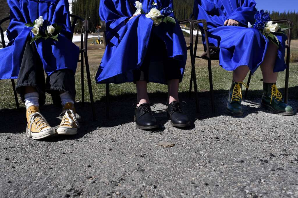 Seniors of The Peak School wear varying footwear during their high school graduation at Copper Mountain Resort on Thursday, May 27.   Photo by Jason Connolly /Jason Connolly Photography