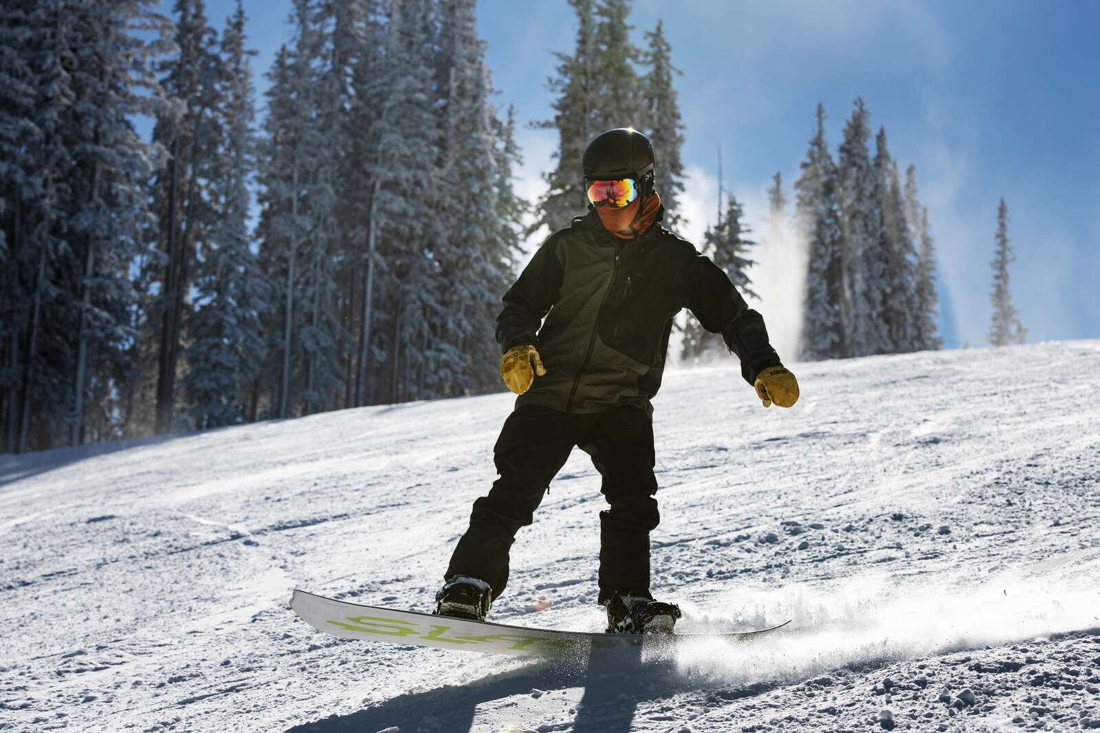 A snowboarder leans back on board on opening day on Aspen Mountain on Wednesday, Nov. 25, 2020. (Kelsey Brunner/The Aspen Times)