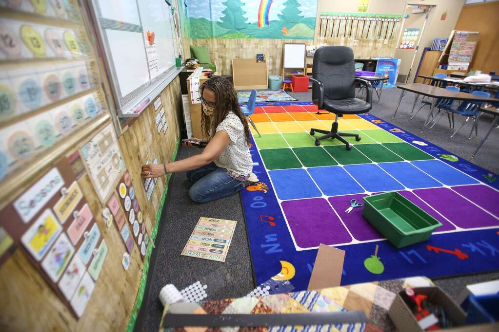 Deer Creek Elementary kindergarten teacher Vanessa Lackey prepares her classroom for the first day of classes Aug. 13 in Nevada City. The school is offering in class and distance education options. About 30 percent of the students are taking part solely in distance learning from Deer Creek Elementary. | Photo: Elias Funez