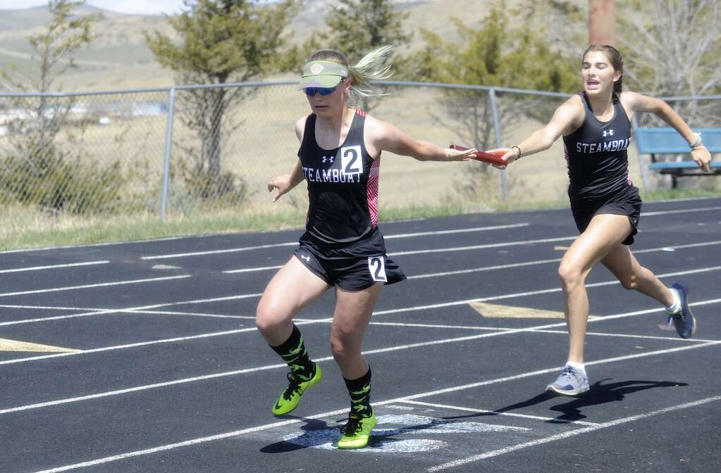Steamboat runners complete a handoff during the 4x200 relay at the Clint Wells Invitational in Craig on Friday. (Photo by Shelby Reardon)