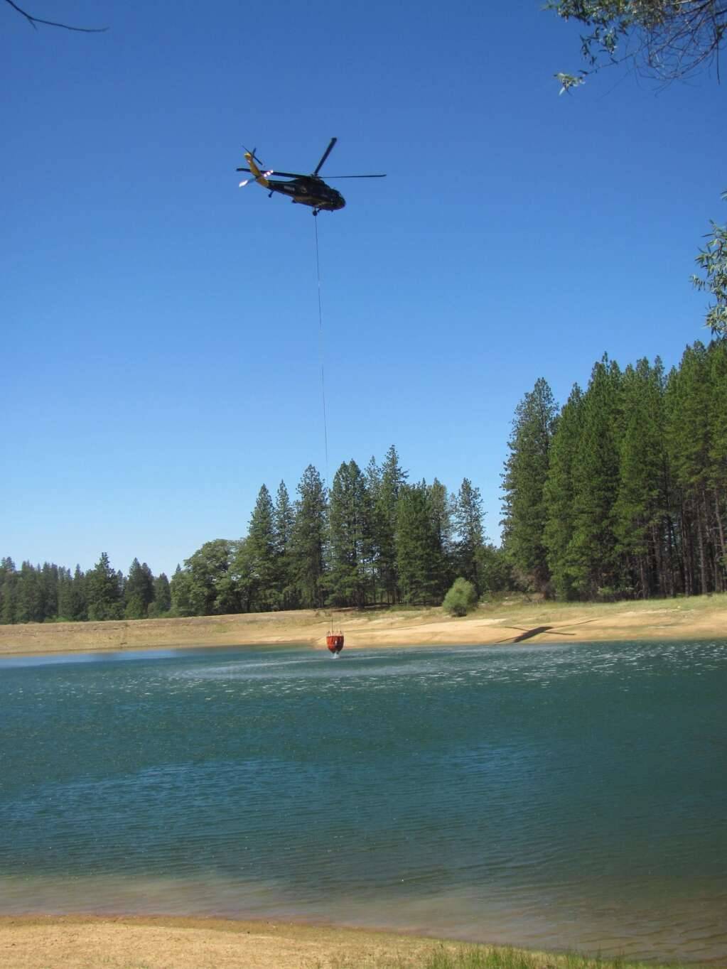 Sharol and Jim Partidos saw smoke rising towards Pleasant Valley Road and Highway 49 at 10:30 a.m. Monday, July 12. At 10:45 a.m., they saw a helicopter taking water out of Pine Grove Reservoir to fight the Pleasant Fire. Thank you firefighters! | Submitted by Jim Partidos