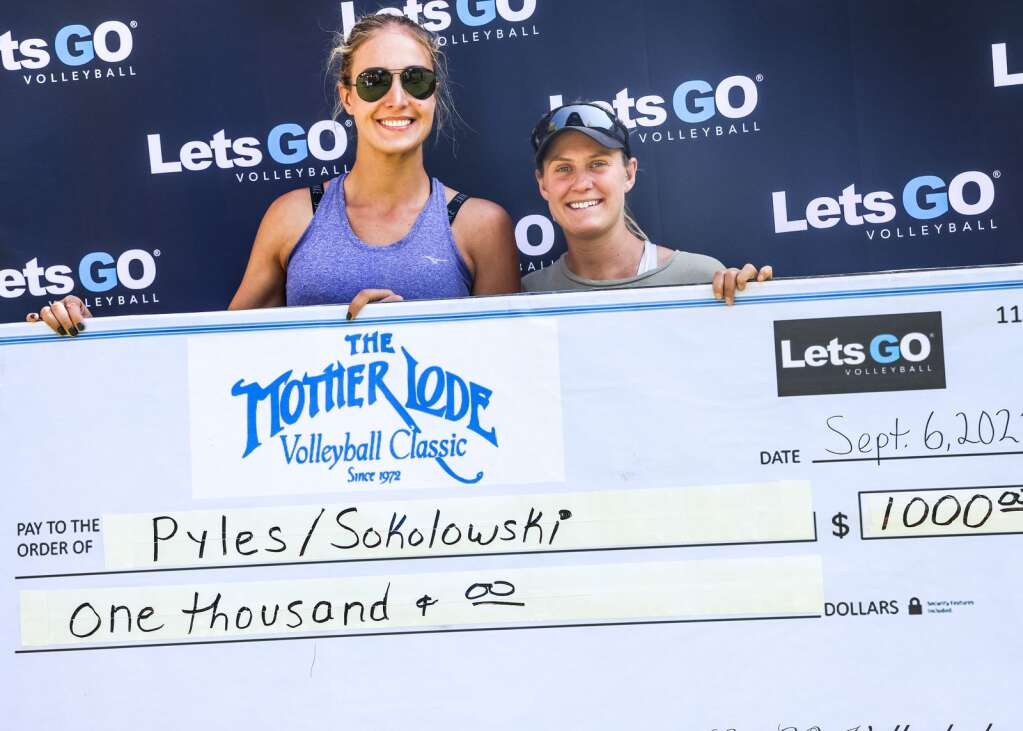 Lena Sokolowski, left, and Katie Pyles pose with the check after winning the women's open finals of the MotherLode Volleyball Classic on Monday, Sept. 6, 2021, at Koch Lumber Park in Aspen. Photo by Austin Colbert/The Aspen Times.