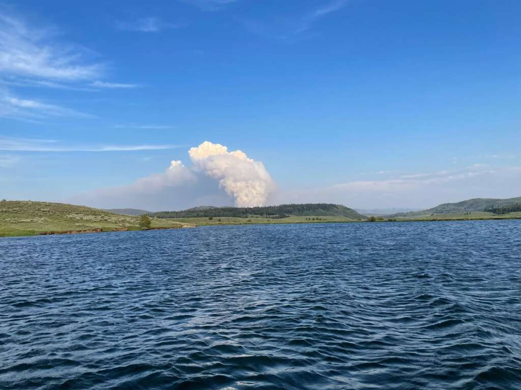 A large cloud of smoke can be seen late Friday from Steamboat Lake. (Photo by Nick Wozniak)