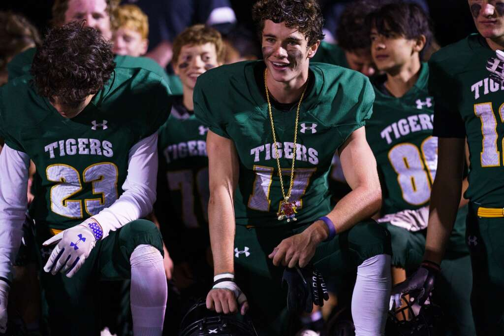 Summit High School senior Aidan Collins, center, celebrates with his teammates after their 37-20 win over the Aspen Skiers Friday, Sept. 10, at Tiger Stadium in Breckenridge. | John Hanson/For the Summit Daily News