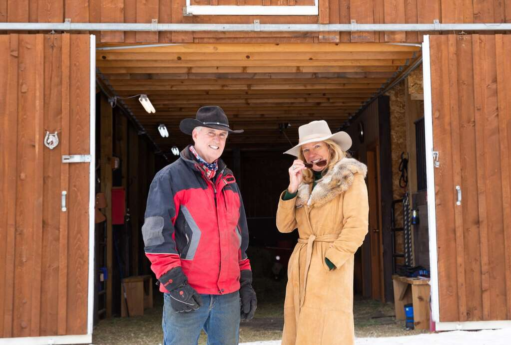 Craig and Lisa Robelen smile for a picture Thursday, Jan. 21, outside the barn at the Breckenridge Equine Center on Tiger Road.   Photo by Liz Copan / Studio Copan