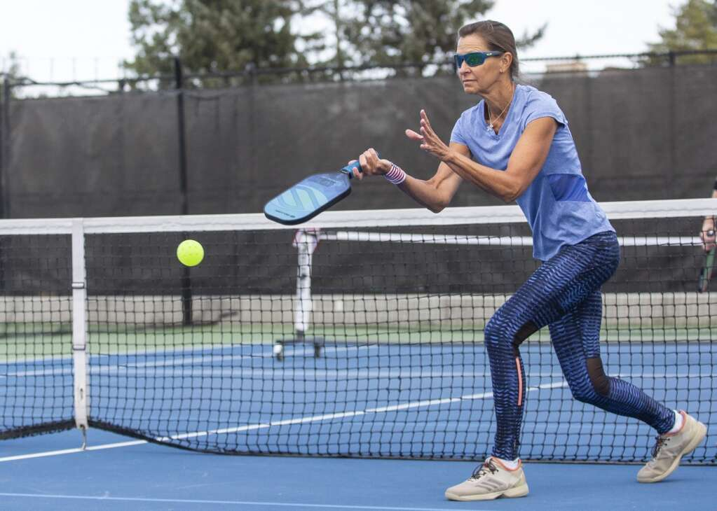 Kirsten Nordstrom returns a volley during a pickleball matchup at the PC MARC during the club's marathon event Saturday morning, Sept. 11, 2021. (Tanzi Propst/Park Record)