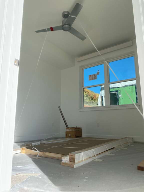 A bedroom in a module for a unit in the third phase of the city's Burlingame Ranch affordable housing subdivision.