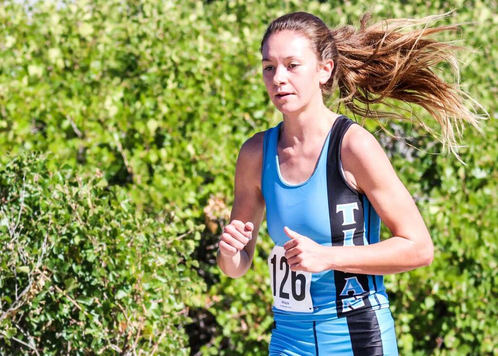 Coal Ridge junior Mikayla Cheney competes in the Longhorn Invitational cross country meet on Saturday, Aug. 28, 2021, at Crown Mountain Park in El Jebel. Photo by Austin Colbert/The Aspen Times.
