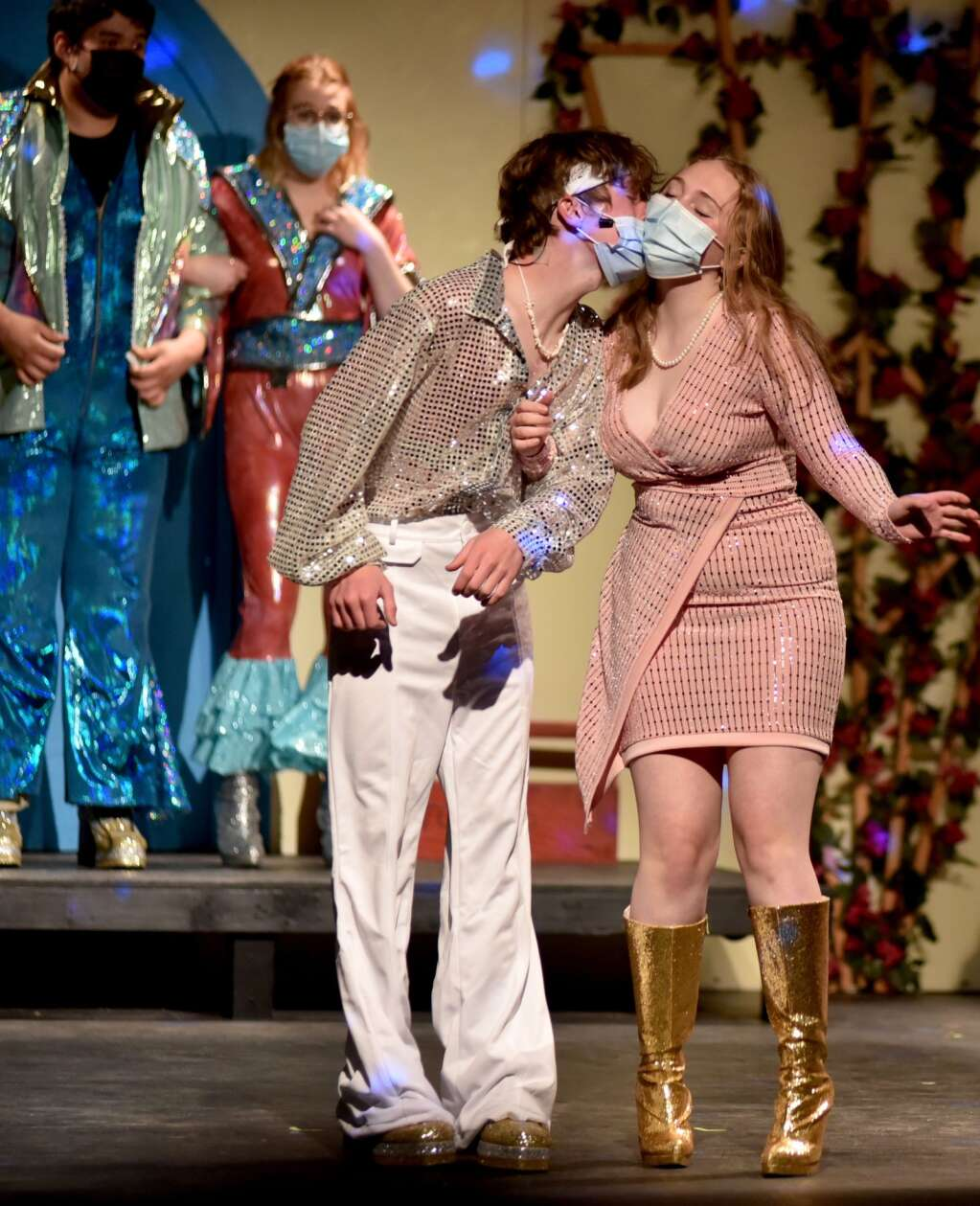 Middle Park junior Connor Murdoch as Sky gives a masked smooch to Olivia Kendziorski as Sophie.