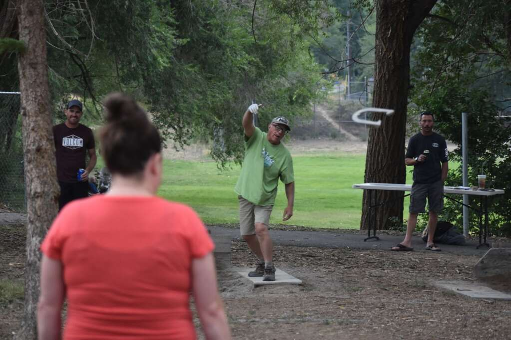 A horseshoe toss contestant tries to hit the pin. |Ray K. Erku / Post Independent