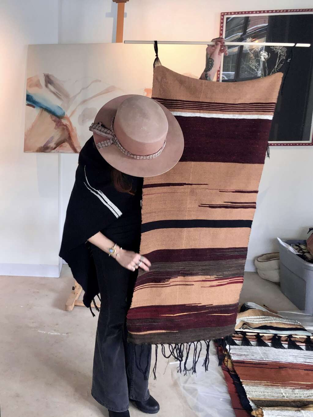 Artist Nina Pivirotto shows off a textile work inspired by the colors of Ruedi Resevoir at Straight Line Studio in Snowmass Base Village on March 15, 2021. | Kaya Williams/The Snowmass Sun