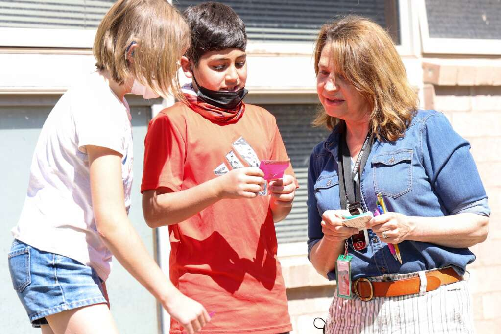 Julie Markalunas Hall, a speech language pathologist through the Aspen School District, works through a treasure hunt with third graders Ardin White, left, and Bashar Akkad, middle, on Tuesday, June 8, 2021, the final day for the AES students this school year. It was also the final day, with students, for Markalunas Hall, who is retiring. Photo by Austin Colbert/The Aspen Times.