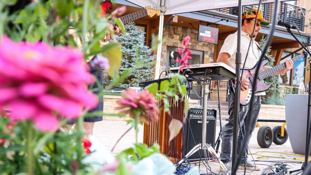 Brian Harrier of the Snowmass-based band Nearly Now performs in front of The Collective on Saturday, July 10, 2021, in Snowmass Base Village. Photo by Austin Colbert/The Aspen Times.