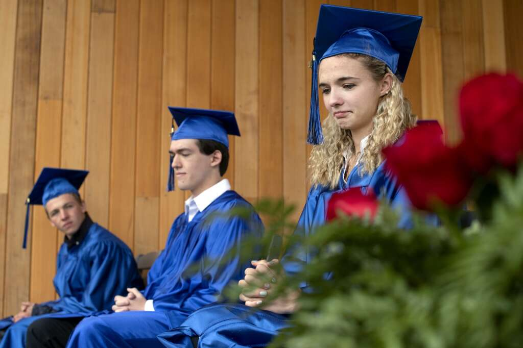 Hannah Thoma listens as teacher William Dye speaks during the Snowy Peaks High School graduation Wednesday, May 26, at the Silverthorne Performing Arts Center in Silverthorne.   Photo by Jason Connolly / Jason Connolly Photography