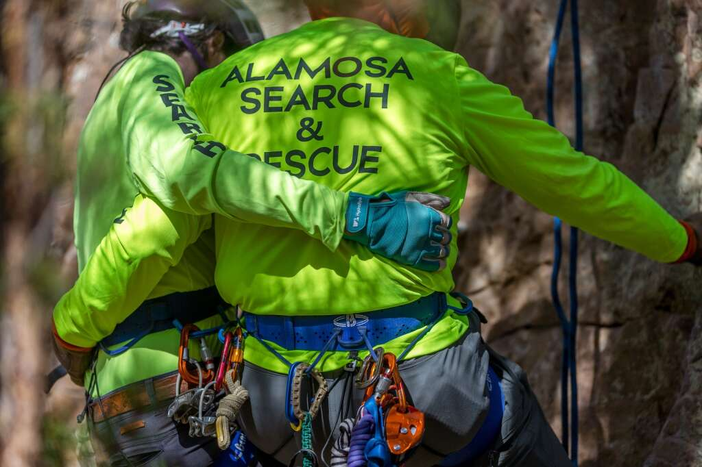 Madeline Ahlborn and Stephen Cline rappelling down a rock face near Windy Point Campground during a search and rescue training session on Friday, September 24.  |  Liz Copan / For the Daily News Summit