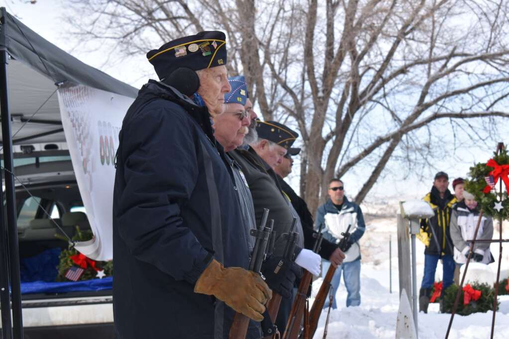 Al Shepherd holds his rifle prior the the honor guard's volley of shots Saturday.