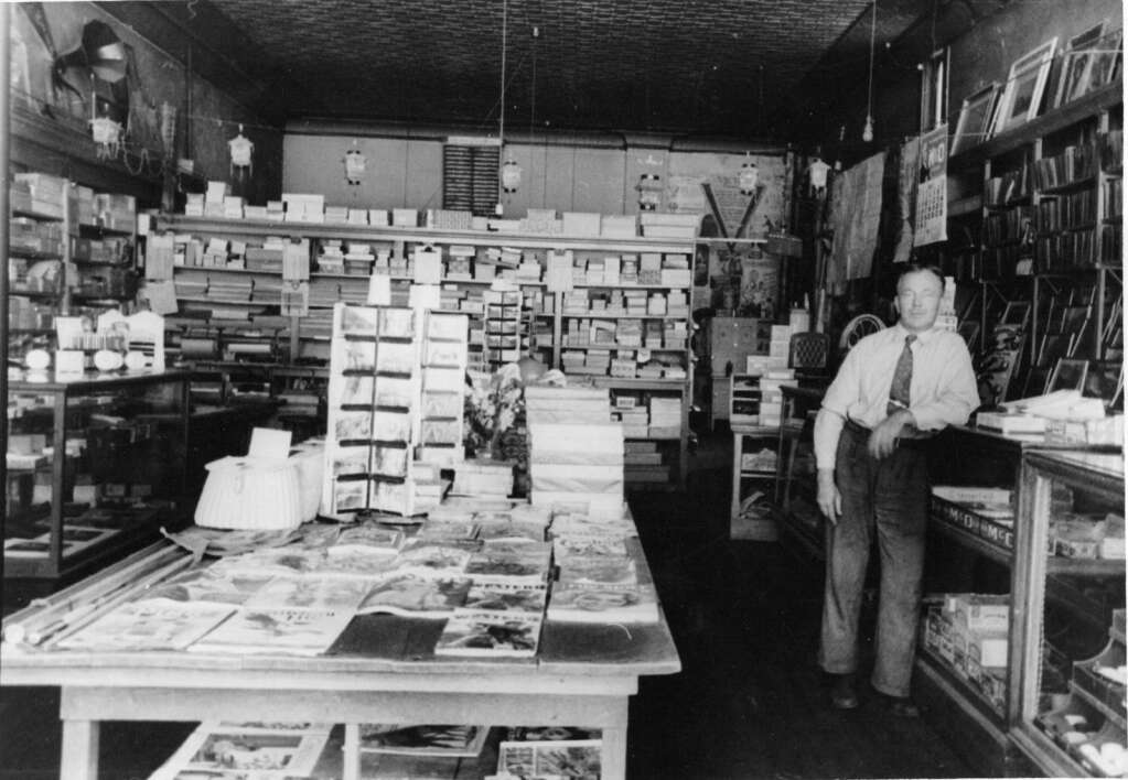 Ted Cooper, Buzz's father, stands in his Cooper Bookstore in a photo circa 1934.   Cooper family/courtesy photo