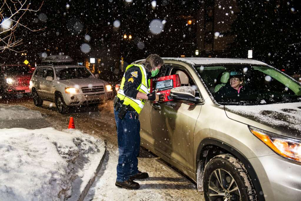 Sgt. Terry Leitch gives a heater to an Aspen resident outside of the Aspen Police Department on Monday, Dec. 28, 2020. In a little over an hour all of the heaters were claimed by residents without heat due to the gas outage in the Aspen area. People waited in line in their cars and walked up to receive their heater. The Aspen Police Department is expecting another truckload of heaters. (Kelsey Brunner/The Aspen Times)