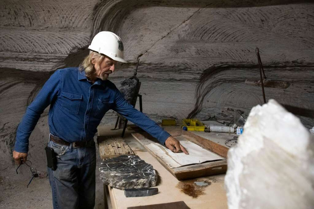 Robert Congdon stands around his art made from Alabaster in his mine outside of Redstone on Thursday, July 29, 2021. (Kelsey Brunner/The Aspen Times)