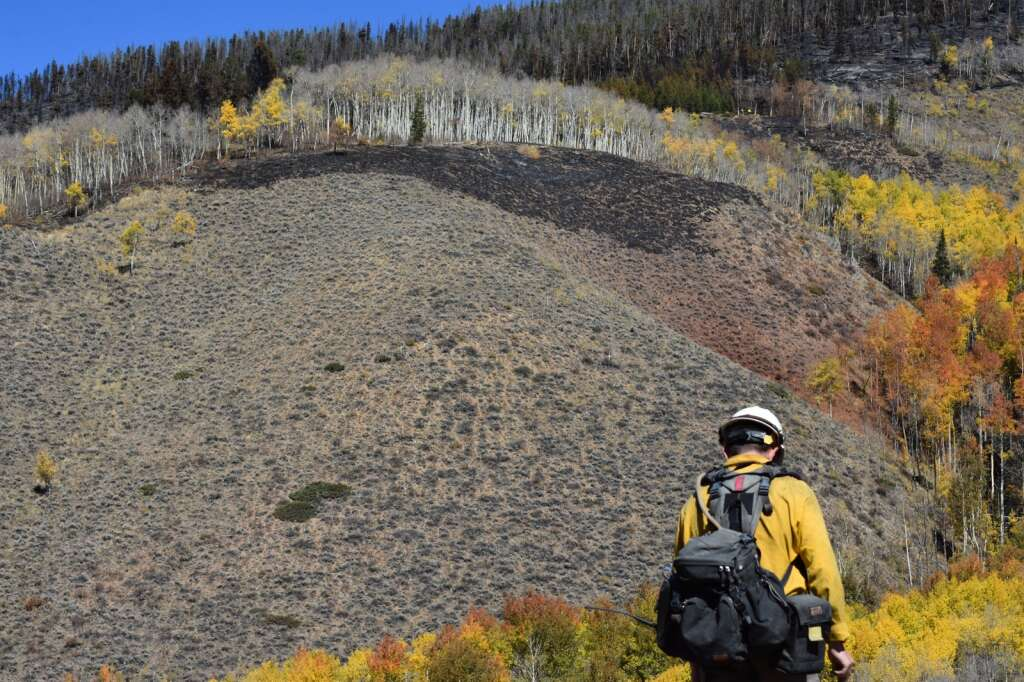 A firefighter hikes up to the Ptarmigan Fire burn area Monday, Oct. 4. | Sawyer D'Argonne/Summit Daily News