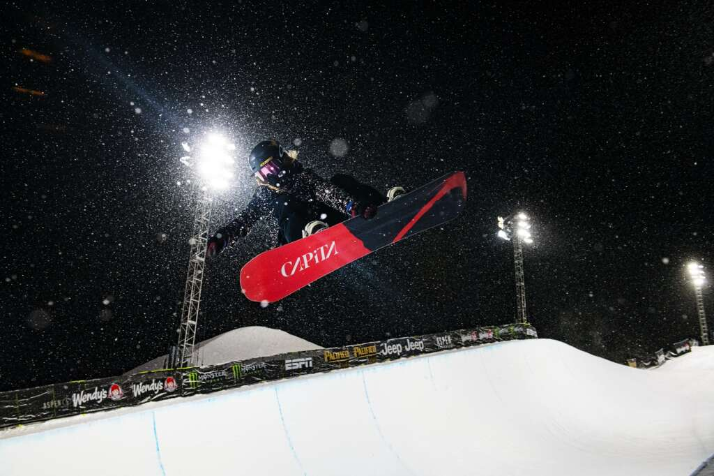 A snowboarder airs out of the Buttermilk superpipe on the first evening of practice for the 2021 X Games Aspen on Tuesday, Jan. 26, 2021.