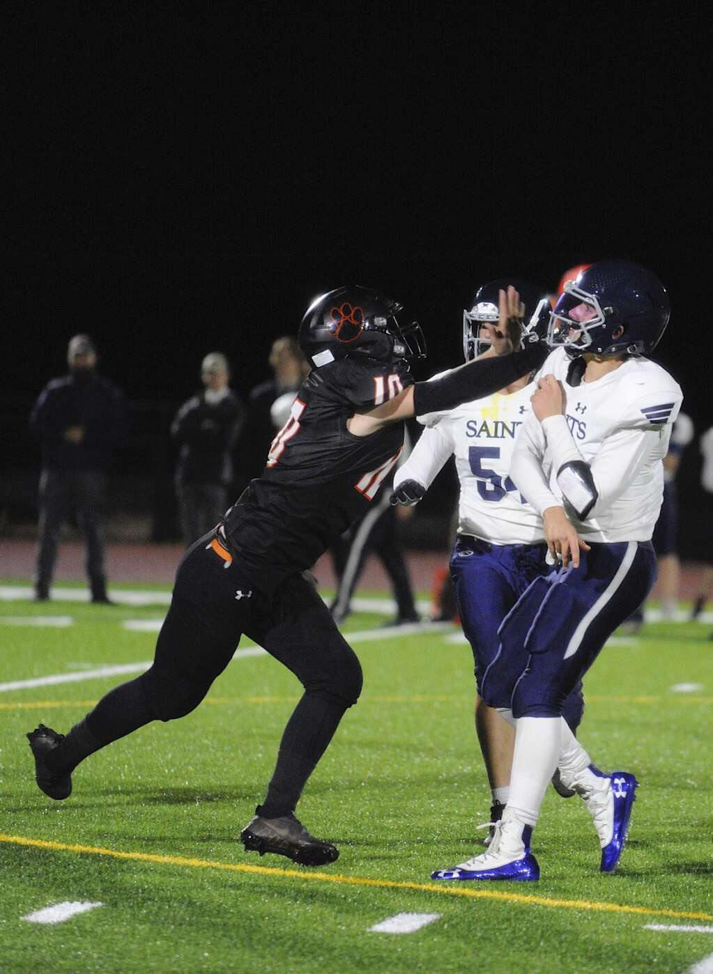 Wesley Gioia, a junior on the Hayden football team, gets in the face of the Saints quarterback during a game against Vail Christian at home on Friday.   Shelby Reardon/Steamboat Pilot & Today