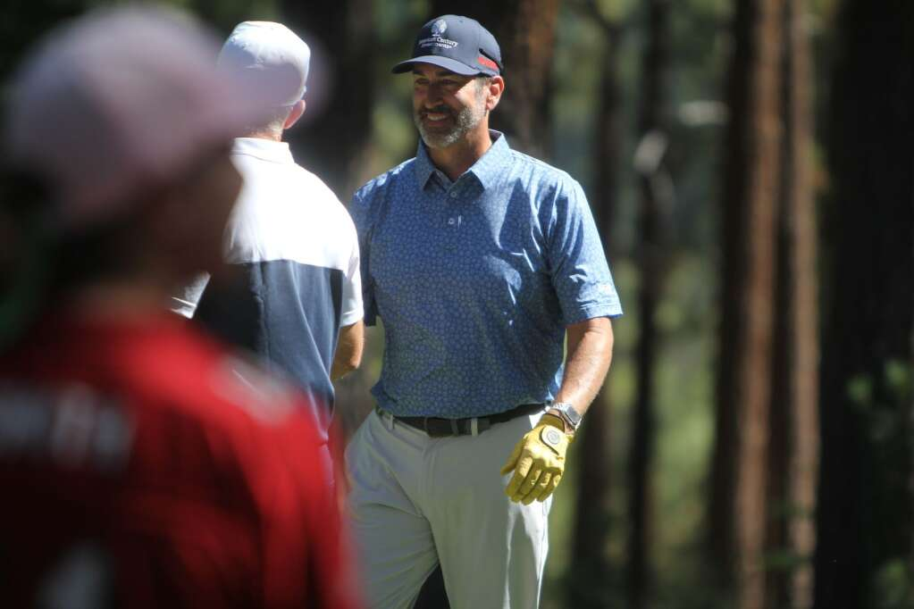 Rob Riggle chats before teeing off.