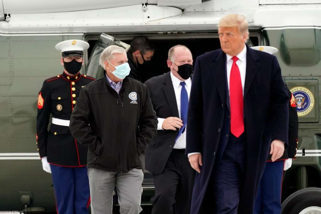 Sen. Lindsey Graham, R-S.C., left, walks with President Donald Trump as they board Air Force One upon arrival at Valley International Airport, Tuesday, Jan. 12, 2021, in Harlingen, Texas, after visiting a section of the border wall with Mexico in Alamo, Texas. (AP Photo/Alex Brandon)