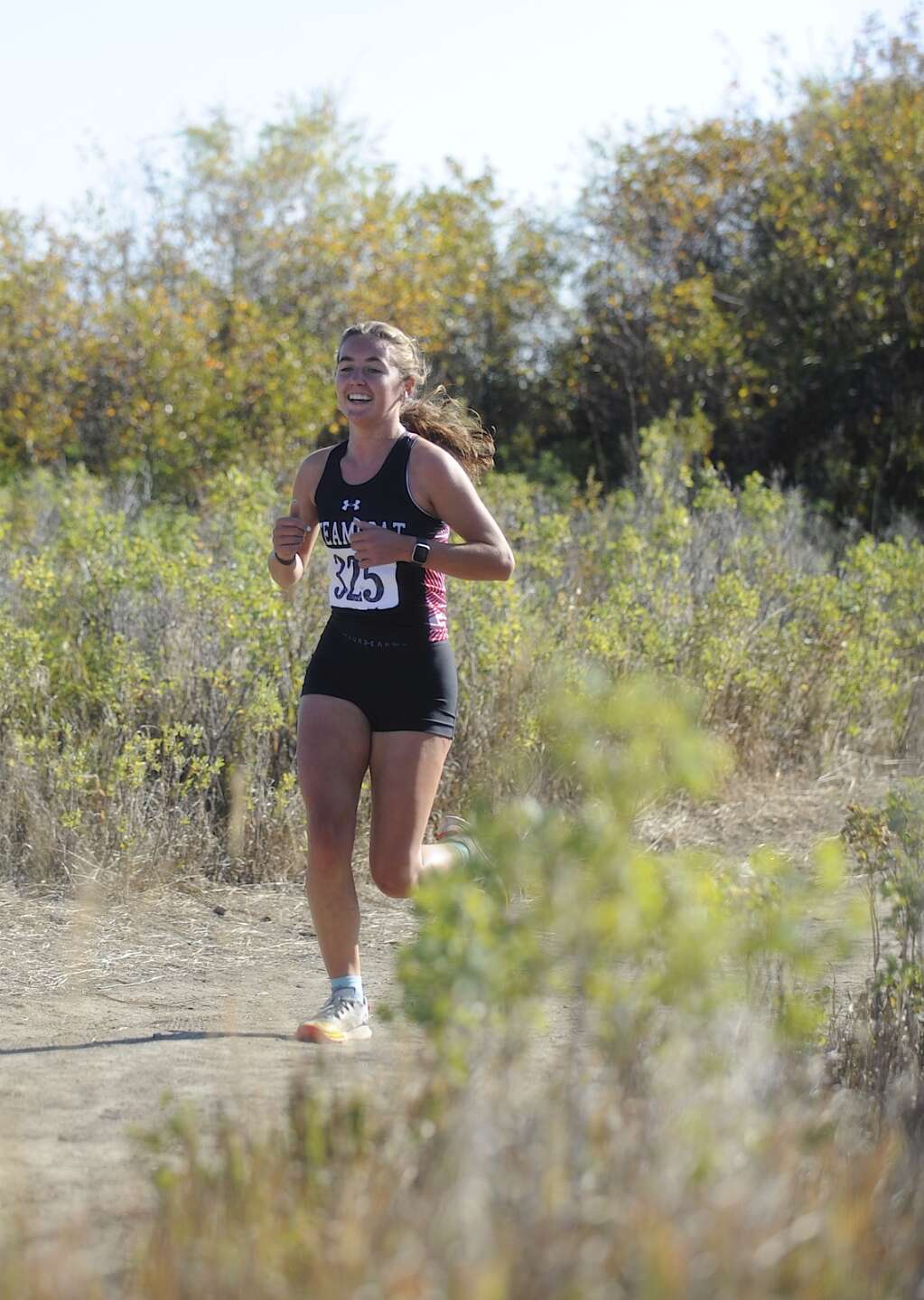 Steamboat Springs senior Courtney Vargas offers a pair of thumbs up while running at a cross country meet at Loudy-Simpson Park in Craig on Saturday morning.   Shelby Reardon/Steamboat Pilot & Today