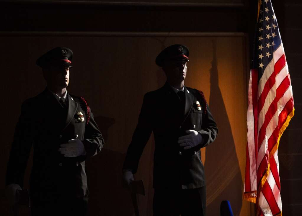 Firefighters stand at attention during the presentation of the flag during a memorial service for late Park City Fire Chief Paul Hewitt. | (Tanzi Propst/Park Record)
