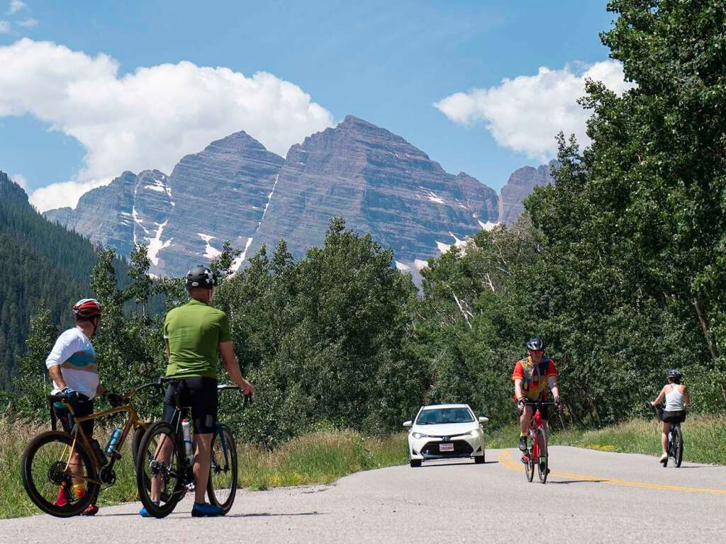 Traditional cyclists, e-bikers and traffic mix on Maroon Creek Road Monday, July 19. | Jim Paussa/Special to The Aspen Times