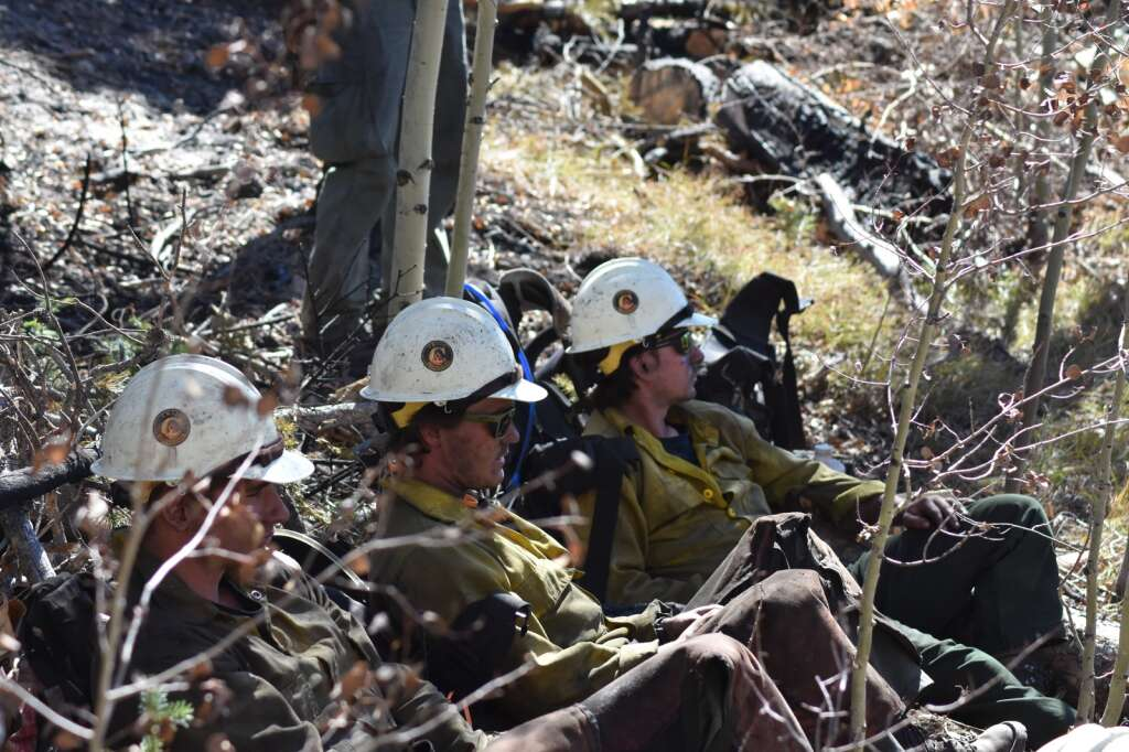 Firefighters with the Craig Hotshot crew take a break from building containment lines on the Ptarmigan Fire on Monday, Oct. 4. | Sawyer D'Argonne/Summit Daily News