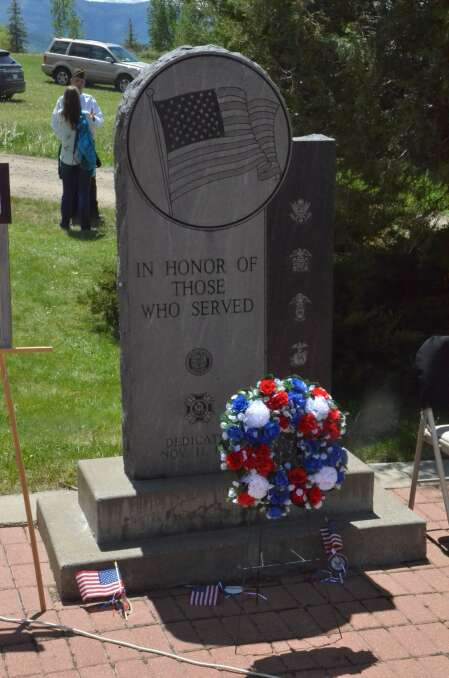 A wreath and three small U.S. flags were placed on the veterans memorial at Steamboat Springs Cemetery, honoring three veterans from Routt County who were killed in action. (Photo by Dylan Anderson)